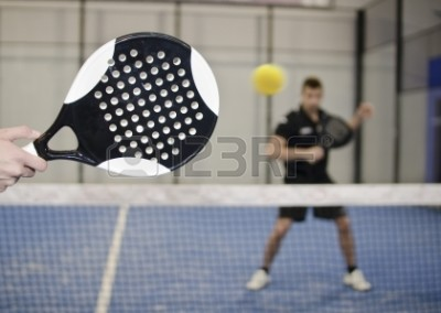 23956200-paddle-tennis-copuple-playing-in-court-with-ball